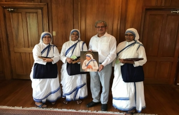Missionaries of Charity sisters called on the Ambassador on 23 August. They presented him with a portrait of Mother Teresa.