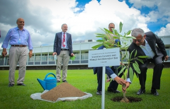 Ambassador Jaideep Mazumdar and Dr. Peter Brothers Chief of Staff of International Rice Research Institute in Philippines, planting a tree at Los Banos to mark the celebration of World Environment Day & 150 years of Mahatma Gandhi, in the Philippines on 7 June 2019.