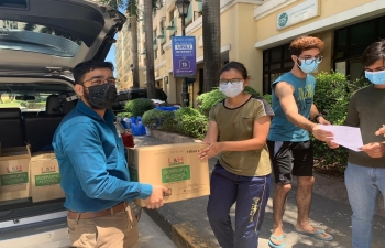 Embassy officials providing masks and hand sanitizers to students of AMA Medical School. Makati on 5 April, 2020.