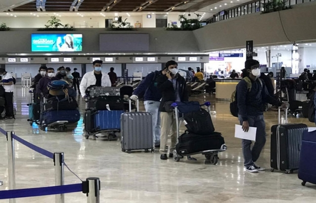 Indians who are in queues to get their boarding passes for the First Air India Vande Bharat Mission special flight out of Philippines for Mumbai.