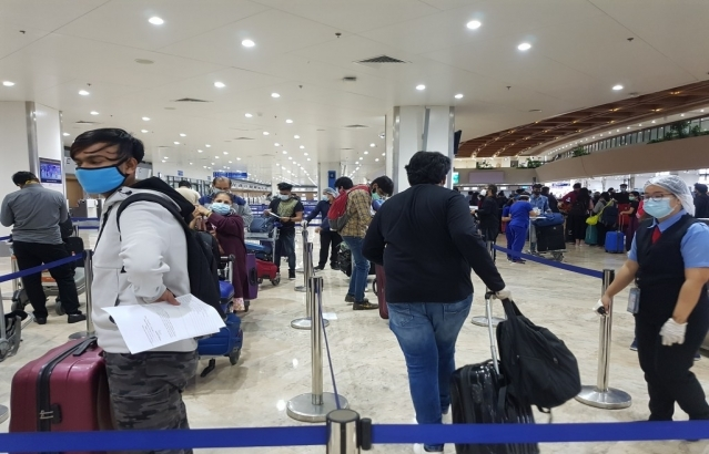 As Check-in counters open up for Manila-New Delhi flight AI 1375, happy passengers line up to complete the travel formalities.