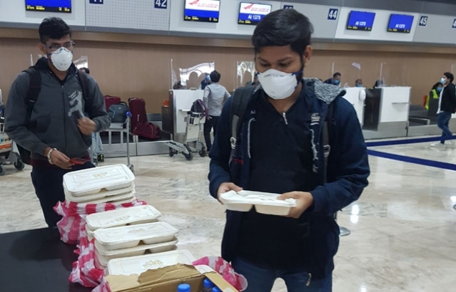 Passengers of 2nd Flight of Vande Bharat Mission AI 1375 from Manila to Ahmedabad are served lunch by the Embassy as they wait for completion of travel formalities at the Manila International Airport.