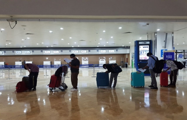 Passengers of AI 1379 practising social distancing at Ninoy Aquino International Airport, Manila.