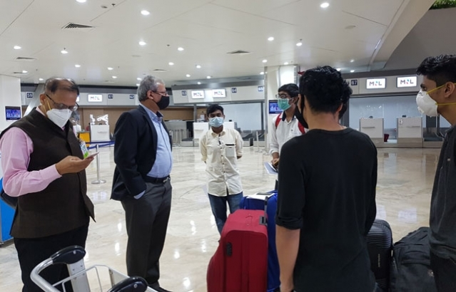 Ambassador Jaideep Mazumdar interacting with the passengers of AI 1319 bound from Manila to Mumbai and Kochi.