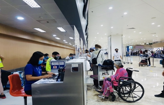 Passengers of AI 1315 start their travel and check-in formalities at the Ninoy Aquino International Airport in Manila.