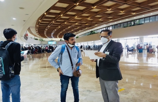 Embassy officials assisting the stranded Indians travelling to India via Air India AI 1315 at the Ninoy Aquino International Airport in Manila.
