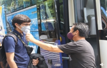 Glimpses of the 12th special flight Vande Bharat Mission in the Philippines.  Passengers of Air India AI 1307 Cebu-Chennai-Kochi arrive at Mactan Cebu Airport by buses arranged by the Embassy and undergo thermal screening before check-in begins.