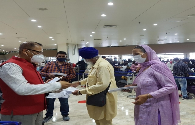 Embassy officials and staff assisting and interacting with the passengers of Air India AI 1311 on 3 July 2020