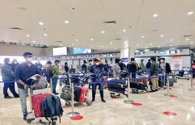 Passengers of Air India AI 1309 bound from Manila to Chennai arrive at Ninoy Aquino International Airport in Manila and begin their check-in formalities on 10 July 2020.