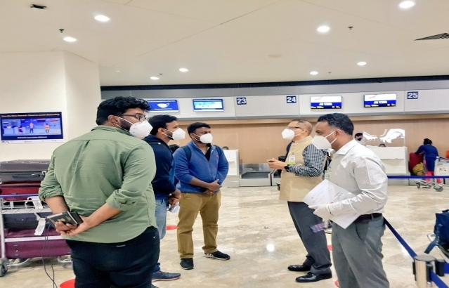 Embassy officials and staff assisting and interacting with the passengers of Air India AI 1309 on 10 July 2020.
