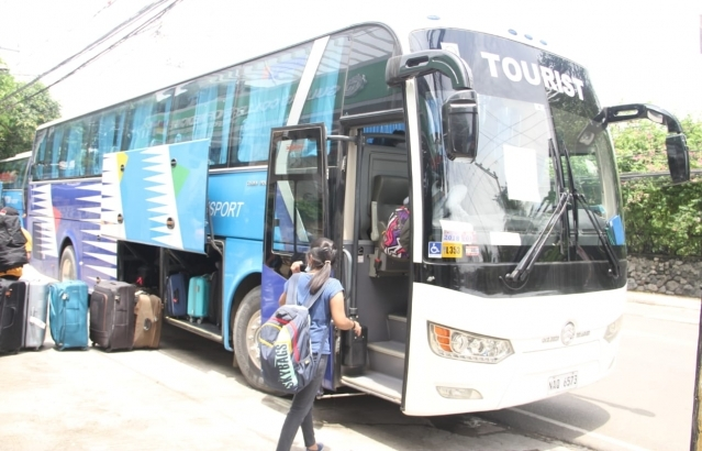 Passengers of Air India AI 1319 bound from Cebu to Chennai arrive at Mactan Cebu Airport by buses provided by Embassy